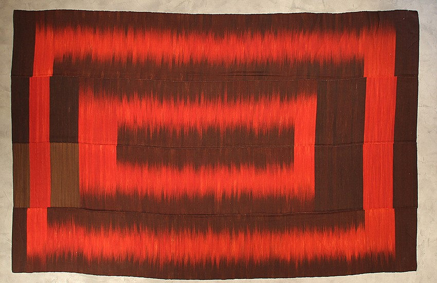 "<p><span class=""viewer-caption-artist"">Iwan Maktabi Collection</span></p> <p><span class=""viewer-caption-title""><i>Mazandaran Hezarjerib IKAT Red & Brown</i></span>, <span class=""viewer-caption-year"">2012</span></p> <p><span class=""viewer-caption-dimensions"">403 x 260 cm (158 5/8 x 102 3/8 in.)</span></p> <p><span class=""viewer-caption-inventory"">IWM0023</span></p> <p><span class=""viewer-caption-aux""></span></p>"