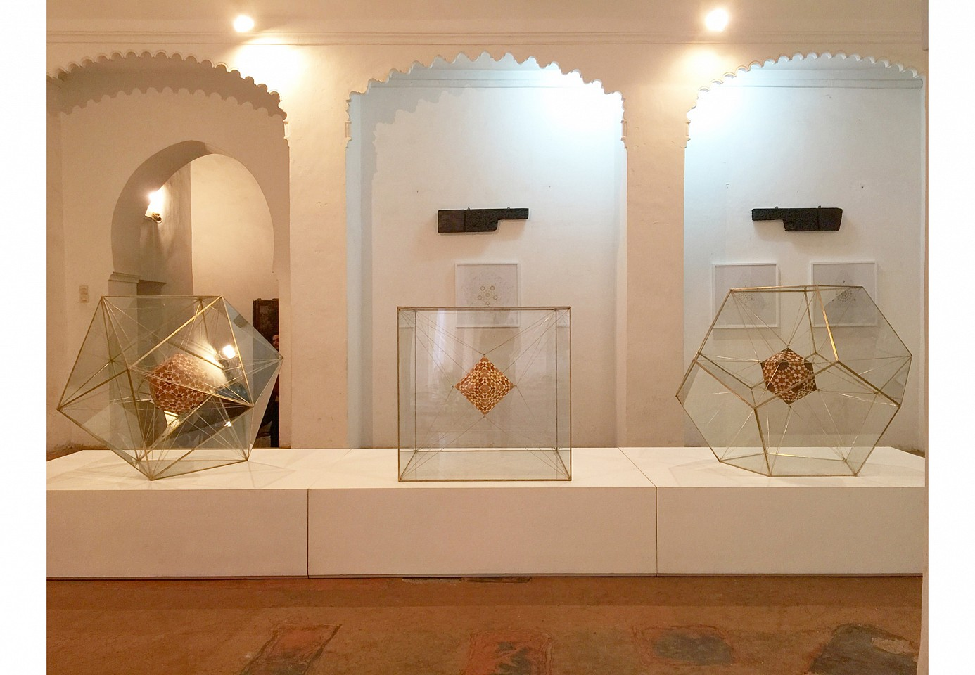 """<p><span class=""""viewer-caption-artist"""">Dana Awartani</span></p> <p><span class=""""viewer-caption-title""""><i>From left to right: Dodecahedron Within an Icosahedron, Octahedron Within a Cube & Icosahedron within a Dodecahedron from The Platonic Solid Duals Series</i></span>, <span class=""""viewer-caption-year"""">2016</span></p> <p><span class=""""viewer-caption-media"""">Shell gold and ink on paper</span></p> <p><span class=""""viewer-caption-inventory"""">DAN0112</span></p> <p><span class=""""viewer-caption-aux""""></span></p>"""