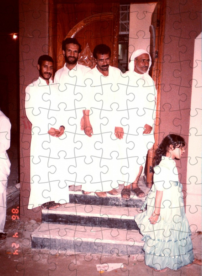 """<p><span class=""""viewer-caption-artist"""">Sarah Abu Abdallah</span></p> <p><span class=""""viewer-caption-title""""><i>Family Members Posing at Our Doorstep  from the series Sanabises</i></span>, <span class=""""viewer-caption-year"""">2017</span></p> <p><span class=""""viewer-caption-media"""">Puzzle pieces (2mm cardboard and with a glossy coated image surface)</span></p> <p><span class=""""viewer-caption-inventory"""">SAA0023</span></p> <p><span class=""""viewer-caption-aux""""></span></p>"""